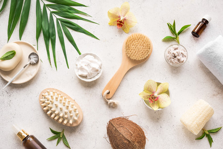 Spa Composition, set, flat lay. Natural spa cosmetics and organic coconut treatment concept on white.