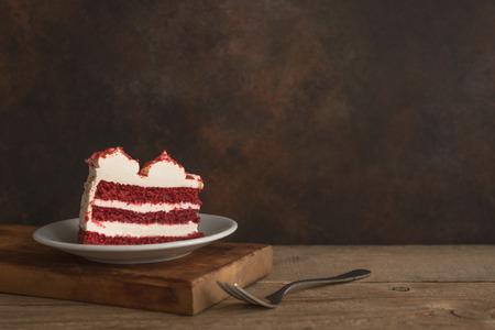 Red Velvet Cake. Piece of Red Velvet Cake on wooden table, copy space.