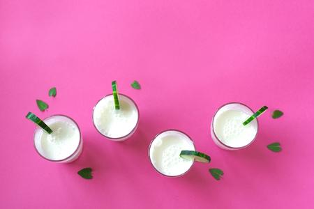 Ayran, homemade yogurt drink (kefir, lassi) with cucumbers - healthy summer refreshing cold drink on pink, copy space. Stock fotó