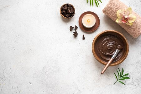 Chocolate Spa flat lay on white background, top view. Natural spa beauty products with chocolate.