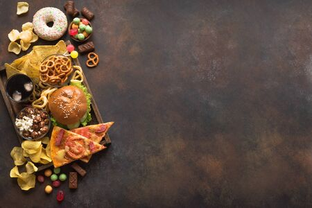 Assortment of Unhealthy Food, top view, copy space. Unhealthy eating, junk food concept. 免版税图像