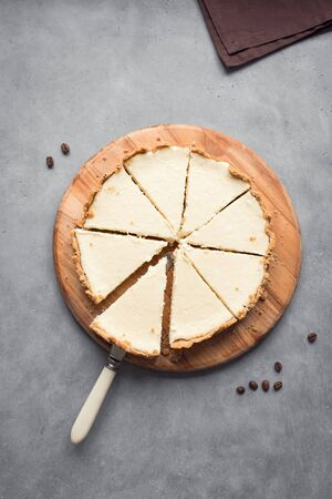 Classic Cheesecake. Cheesecake New York on grey background, top view, copy space.