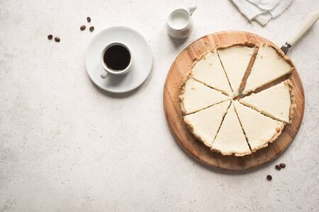 Classic Cheesecake. Cheesecake New York and coffee on white background, top view, copy space.