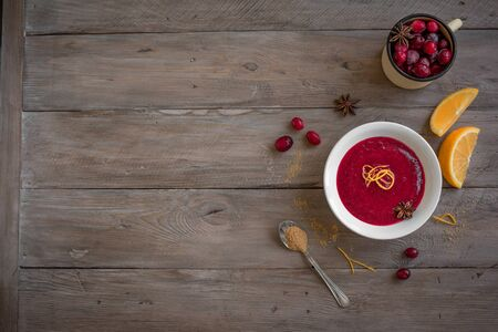 Homemade Cranberry Orange Sauce (Relish) for Thanksgiving or Christmas on wooden, copy space. Traditional festive Cranberry Sauce with ingredients.