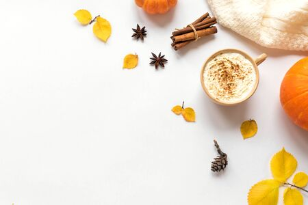 Autumn flat lay with coffee Pumpkin Spice Latte isolated on white background. Cup of coffee with seasonal autumnal leaves and pumpkins, copy space. Stock Photo