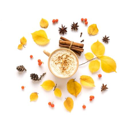 Autumn composition with coffee Pumpkin Spice Latte isolated on white background. Cup of coffee with seasonal autumnal leaves, copy space.