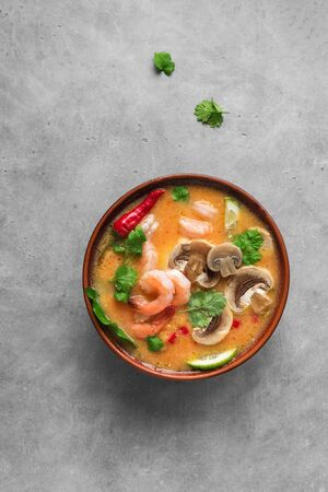 Tom Yum Kung Soup, top view, copy space. Traditional thai asian spicy coconut milk soup with shrimps - tom yam soup.