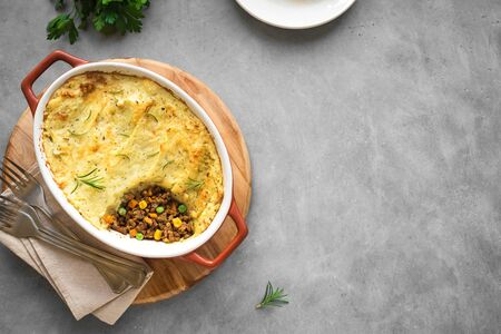 Shepherds Pie with ground beef, potato and cheese on concrete background, top view, copy space. Traditional homemade casserole - Shepherds Pie.