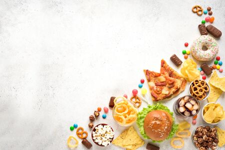 Assortment of Unhealthy Food on white, top view, copy space. Unhealthy eating, junk food concept. 免版税图像