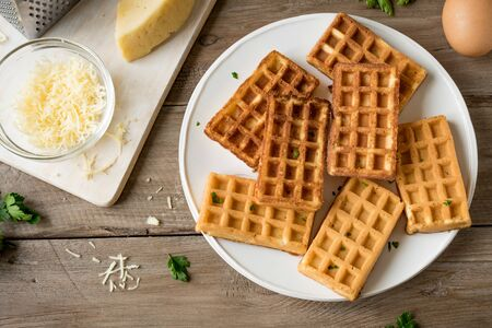 Savory egg and cheese waffles (chaffles) for breakfast. Keto (ketogenic) recipe - morning protein waffles, close up. 写真素材