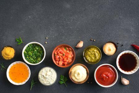 Set of various sauces. Popular sauces in bowls, top view, copy space. Homemade sauces or dip. Reklamní fotografie