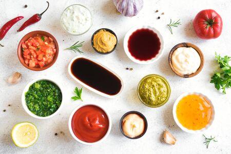 Set of various sauces. Popular sauces in bowls, top view, flat lay. Homemade sauces or dip. Reklamní fotografie