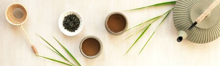 Green Tea Composition with bamboo leaves. Chinese traditional tea set, tea culture concept, top view, copy space.