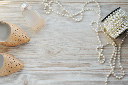 shoes, perfume and beads on the table. Concept of femininity and beauty Stock Photo