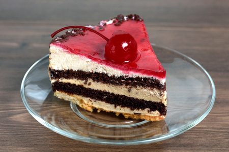 Delicious chocolate-cherry cake on plate on table Stock Photo