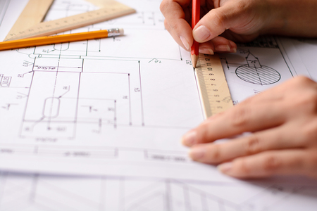 Architect sketching a construction project, view from the top Stock Photo