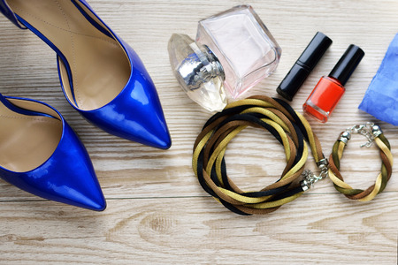 beautifu: Jeans, shoes and perfume on the wooden background