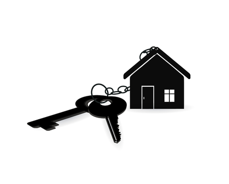 House key on a house shaped keychain. concept for real estate, moving home or renting property