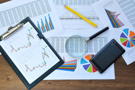 Financial printed paper charts, graphs and diagrams. Science and technology.