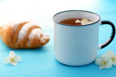 Jasmine tea with jasmine herb flower on a wooden table background.