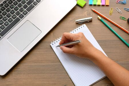 handwriting, hand writes a pen in a notebook Stock Photo