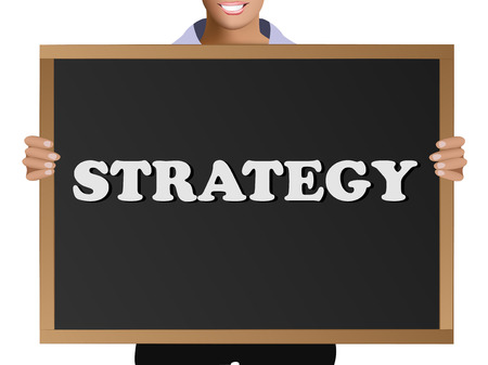 Girl in casual clothes holding a black chalk board with the text Strategy