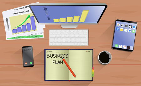 Top view on laptop computer with mobile phone and tablet on office desk. With Business notebook (diary) with text Business Plan. Modern business workplace