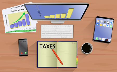 Top view on laptop computer with mobile phone and tablet on office desk. With Business notebook (diary) with text Taxes. Modern business workplace