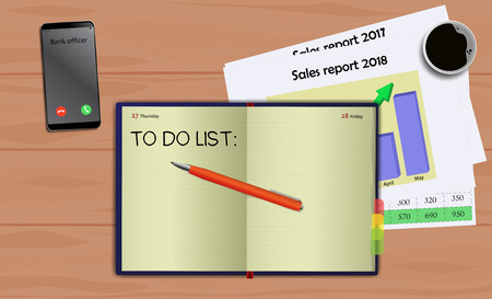 Business notebook (diary) with text To do list. With free blank space for your text. On business desk with reports, mobile and coffee