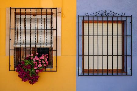 xp: A couple of beautiful  colored windows in Xania, Spain