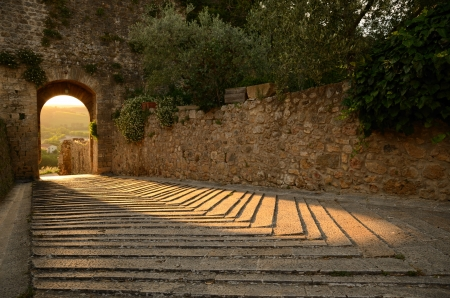 backlights: The warm light of a sunset plays with the stones of an ancient castle