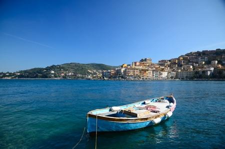 A beautiful raw boat in the bay of Porto Santo Stefano Stock Photo