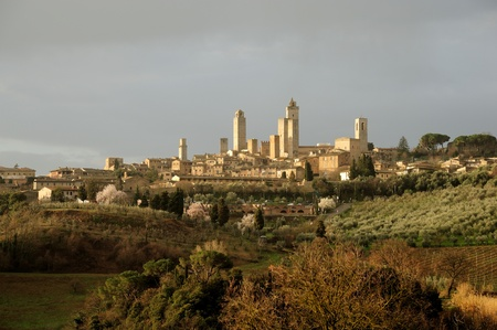 The landscape around the village of San gimignano in Tuscany photo