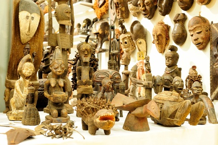 Traditional African handicraft. Wood statues in a market photo