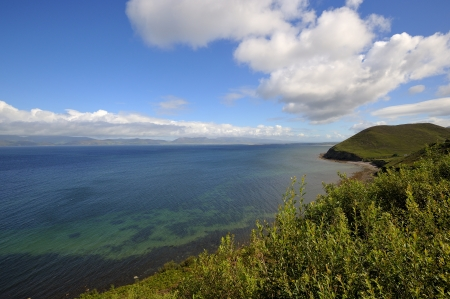 Coumeenole beach, coast of Dingle Peninsula and Coumeenoole Bay, in summer, Ireland. photo