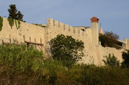 krk: Seaview of fortifications and church of Krk village on Krk island in Croatia Stock Photo