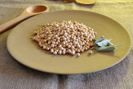 Dried chickpeas on a brown background