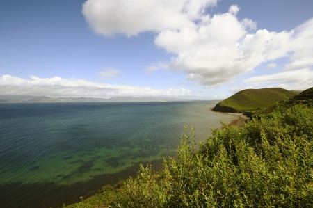 dunquin: Coumeenole beach, coast of Dingle Peninsula and Coumeenoole Bay, in summer, Ireland  Stock Photo