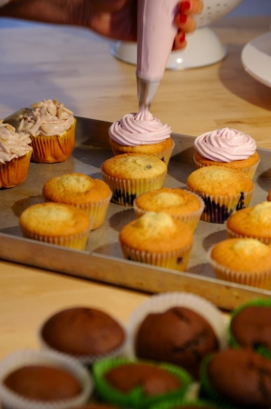 sweats: The preparation of tastefully beautiful cupcakes Stock Photo