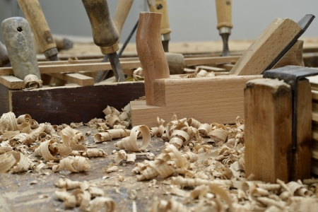 A wooden desk of a carpenter with some tools