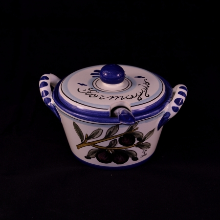 A beautiful decorated pottery cheese bowl on a black backgrund photo