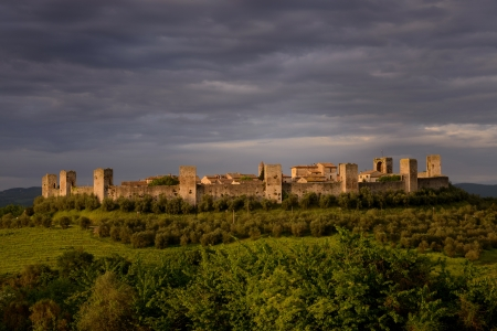 hillock: Photos of Monteriggioni, a medieval walled town located on a natural hillock, in the Siena Province of Tuscany Stock Photo