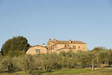 grass plot: A tipycal stone farm house in Tuscany Stock Photo