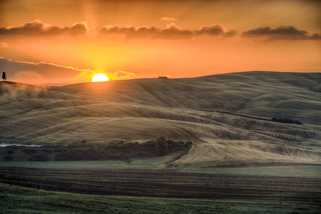 described: Crete Senesi Crete Senesi are literally Siennese clays and the distinctive gray coloration of the soil gives the landscape an appearance often described as lunar