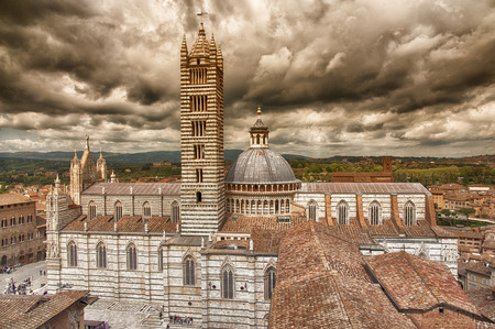 assumed: The cathedral of Siena under a dramatic sky