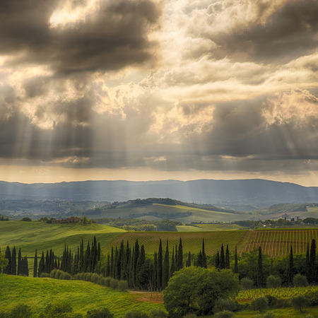 podere: Ray of light over the tuscan hills Stock Photo