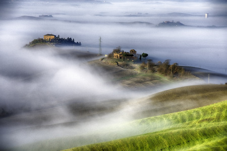 podere: A misty morning over the hills of Tuscany