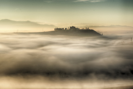to seem: At morning the hills of tuscany seem islands in a sea of fog Stock Photo