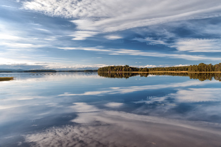 A swedish lake in summertime with cloud reflection Stock Photo