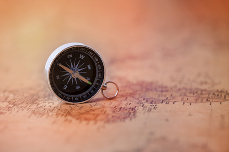 Compass on vintage map. Travel and adventure Concept.